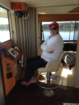 Colin driving the houseboat - Coomera